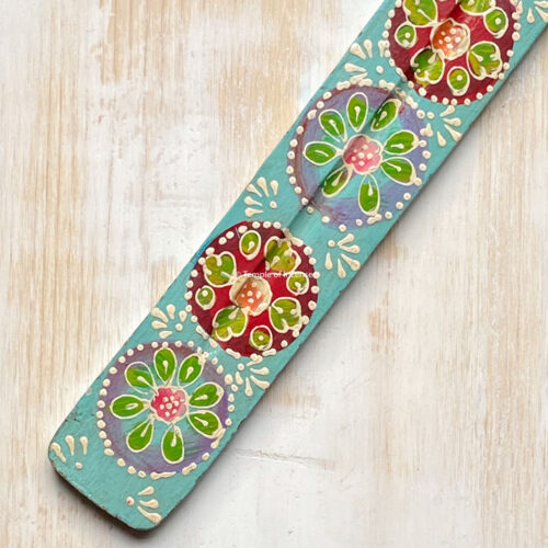 turquoise hand painted wooden incense stick holder.