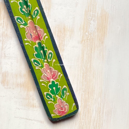 green hand painted wooden incense stick holder.